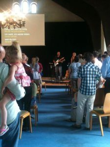 Roddy on stage leading worship on 7/7/13, the Dinsmore's last day at Mavuno Berlin.